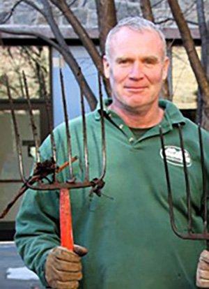 Dwight Darkow with pitchfork