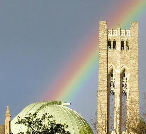 Rainbow stretching between the Sproul dome and Clothier Bell Tower.