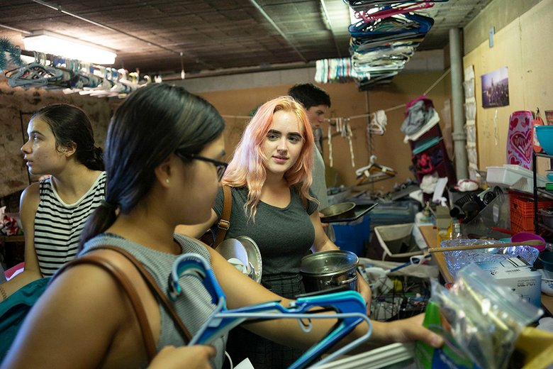 Students sort through secondhand clothes at Worthmore
