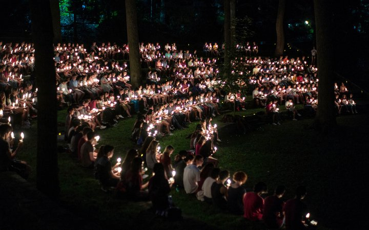 Students with candles at first collection