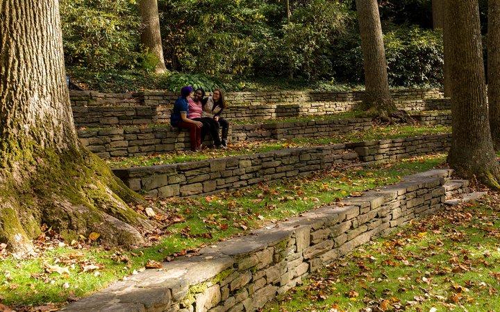 Three students talking in the amphitheater