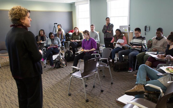 Instructor presenting to room full of students at the Lang Center