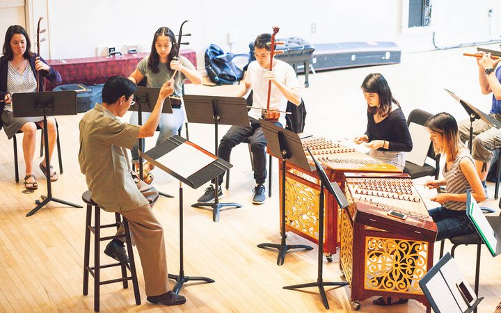 Students practicing musical instruments