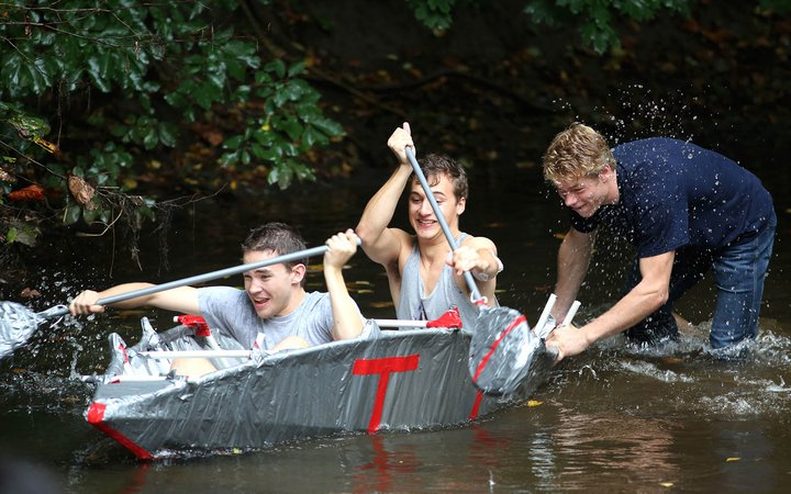 Students on canoe in a creek