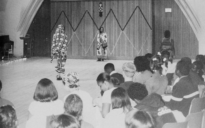 Members of SASA perform in a fashion show as part of a presentation of African culture, 1999.