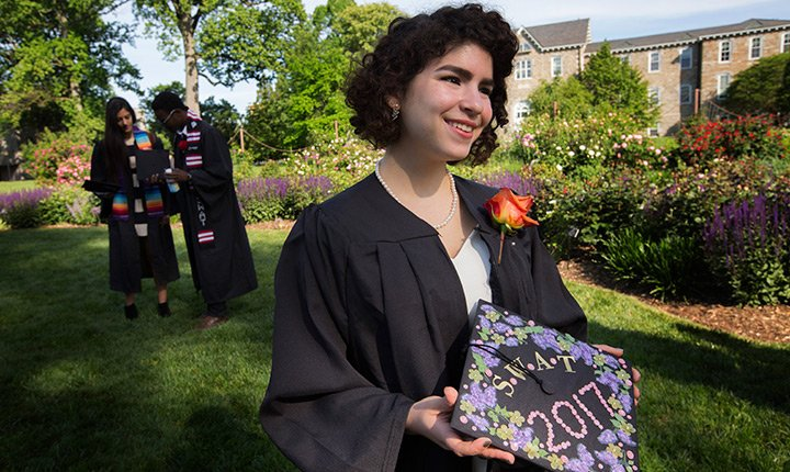 student showing off her mortar board