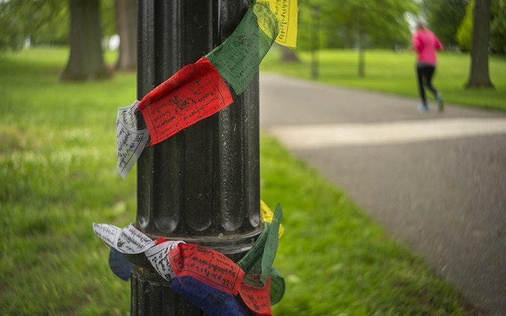 Prayer flags wrapped around lamp post in honor of Sam Jenkins '19