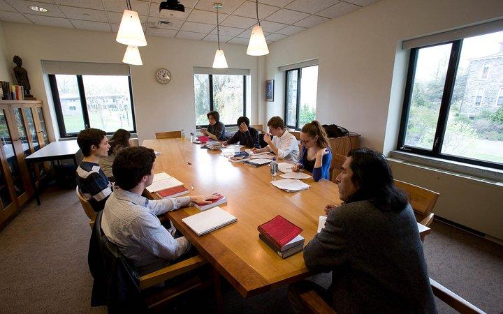 A classroom shot of a seminar room in Kohlberg Hall