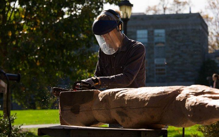 Student sculpting wood