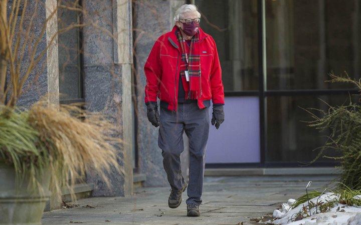 faculty member walking in snow