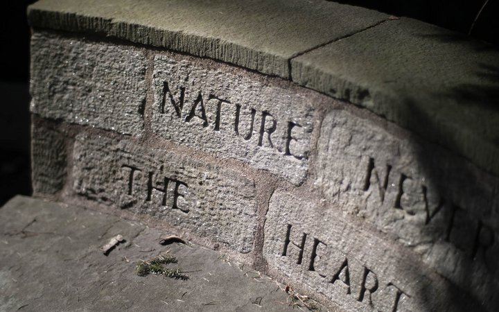 stone bench with inscription carved into back