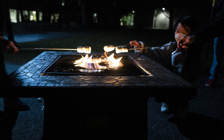 students roasting marshmellows