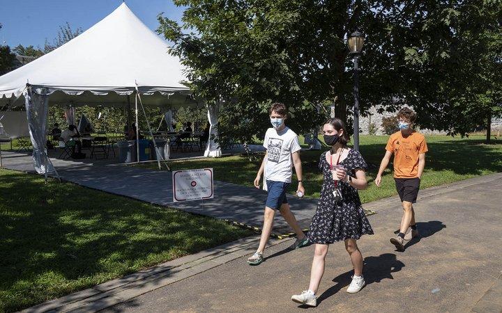 three students walking