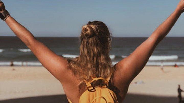 student looking at sea