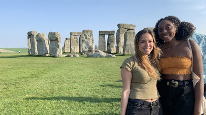 two students in front of stonehedge