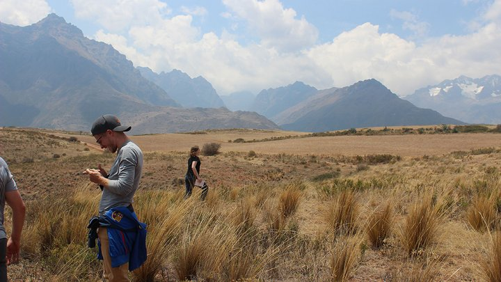 students in mountainous landscape