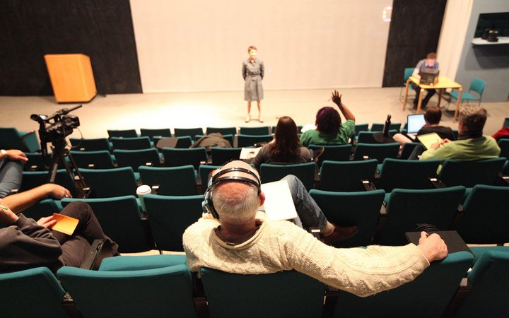 Lang Performing Arts Center staff watch performers practice