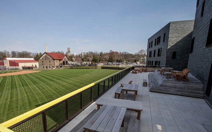 Terrace overlooking baseball field on sunny day