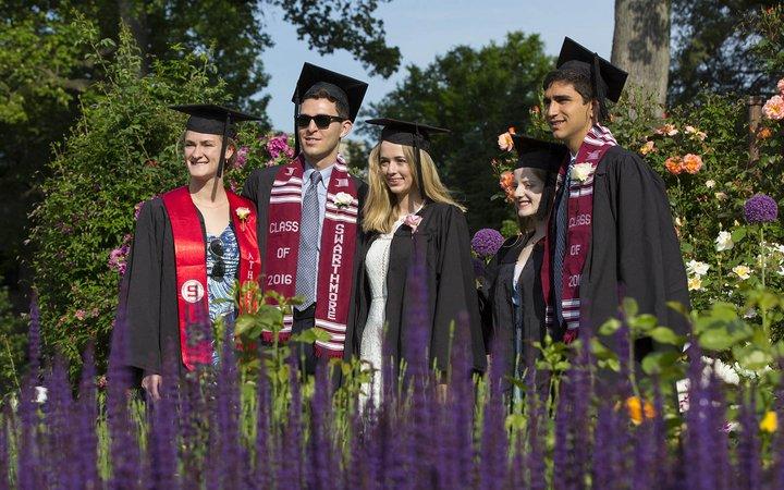 graduates posing in rose garden