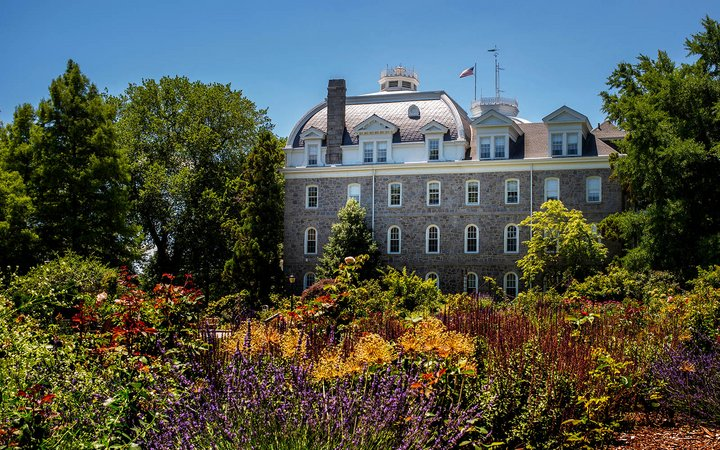 rose garden in bloom and parrish hall