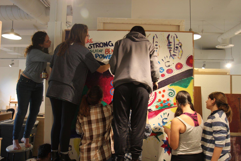 2017 Seniors creating a group mural.