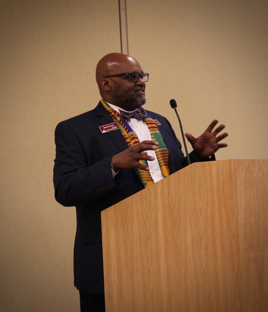 Dion Lewis speaks at podium