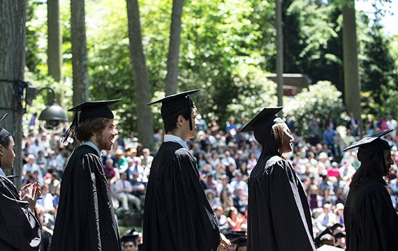Students line up to receive their degrees