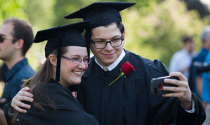 graduates posing for a selfie
