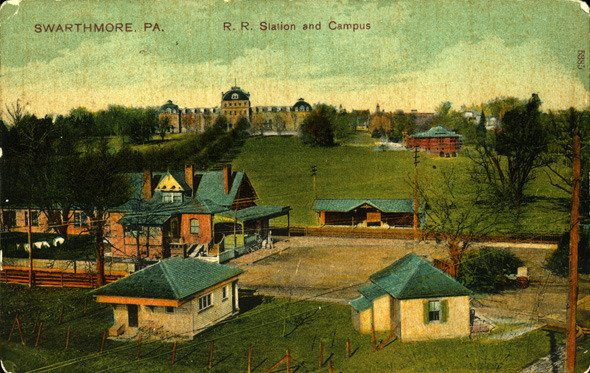 Colored postcard of the Swarthmore train station, looking up to Parrish Hall on the Swarthmore College campus