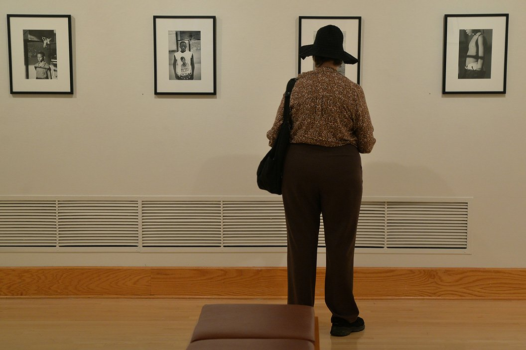 Woman views art in List gallery
