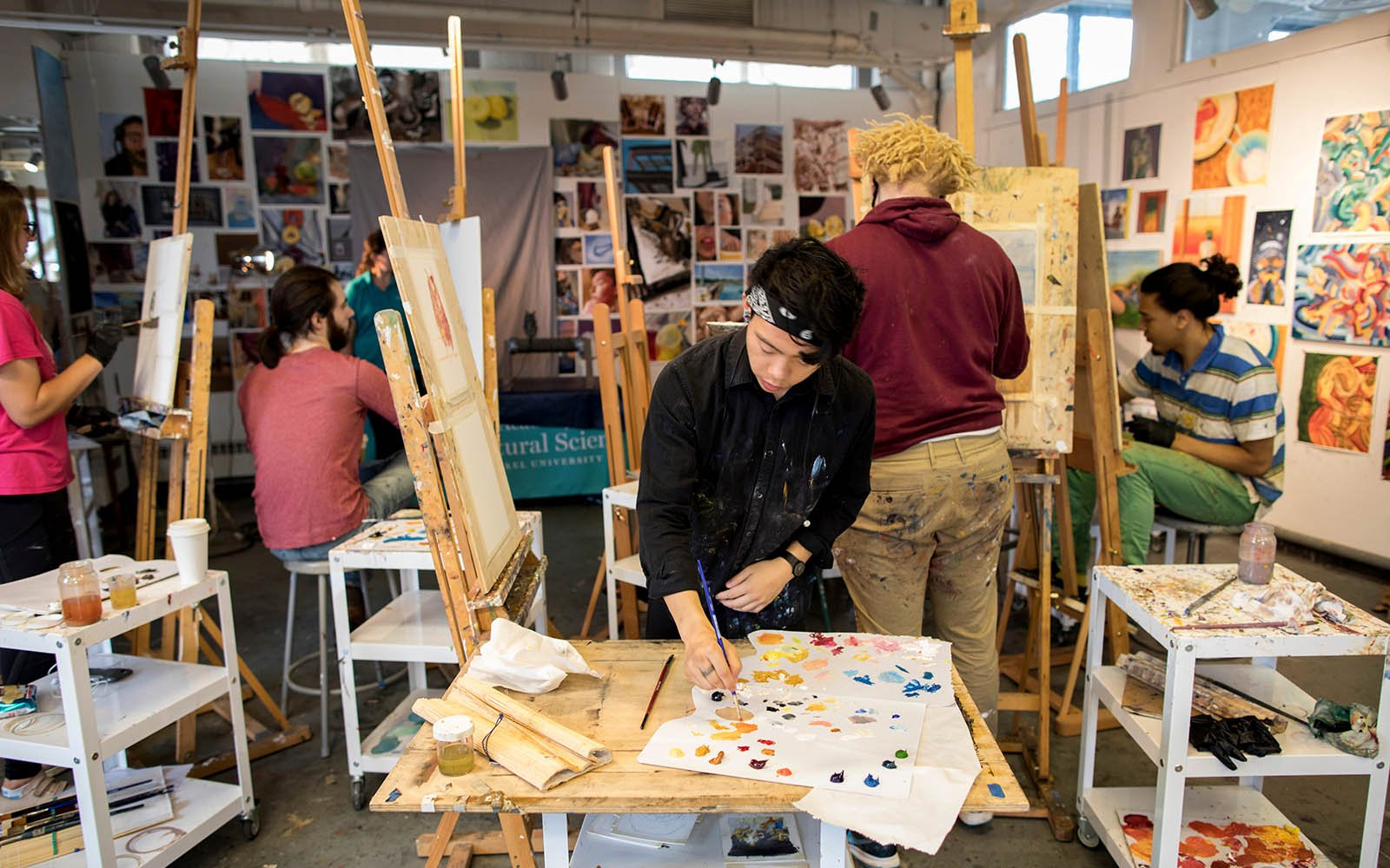 Student working on art in a studio
