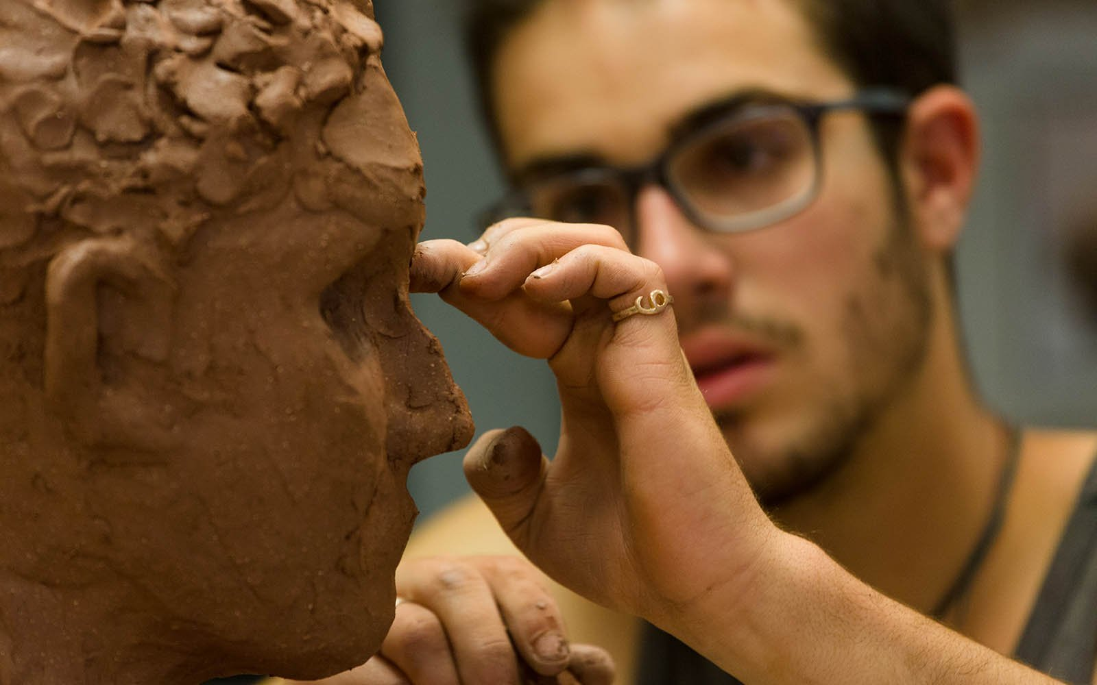 Student working on a sculpture