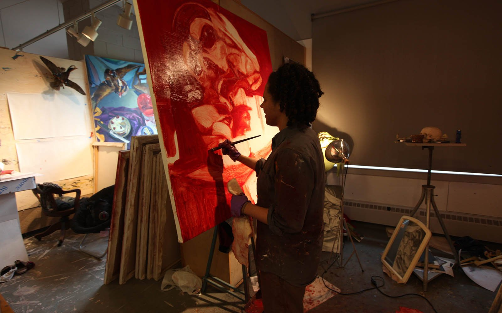 Student painting in a studio