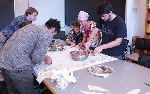 Students make dumplings