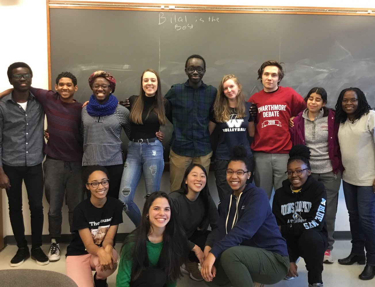 Students in front of blackboard