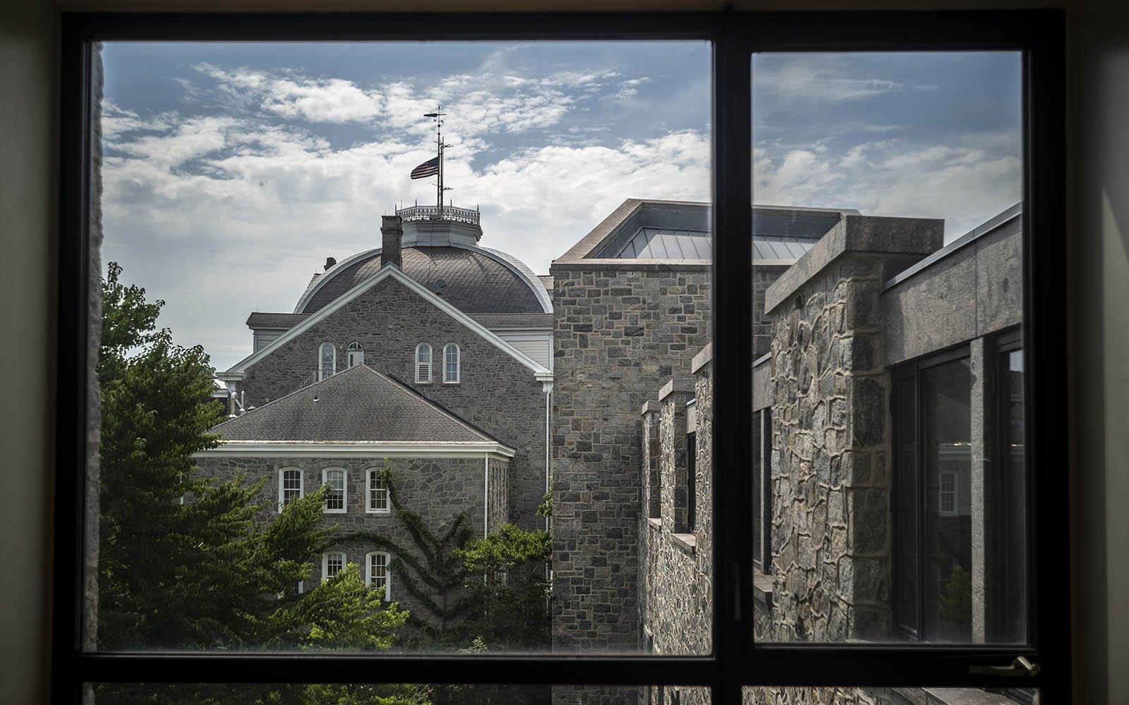 Looking through Kohlberg Hall window