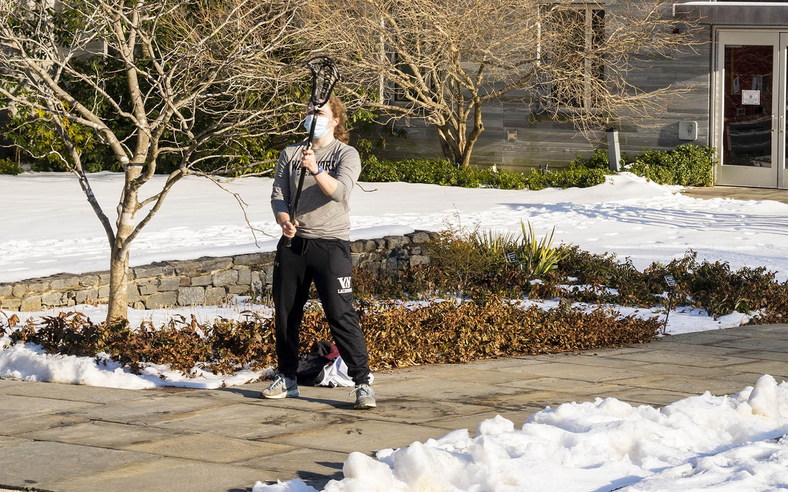 student practicing lacrosse