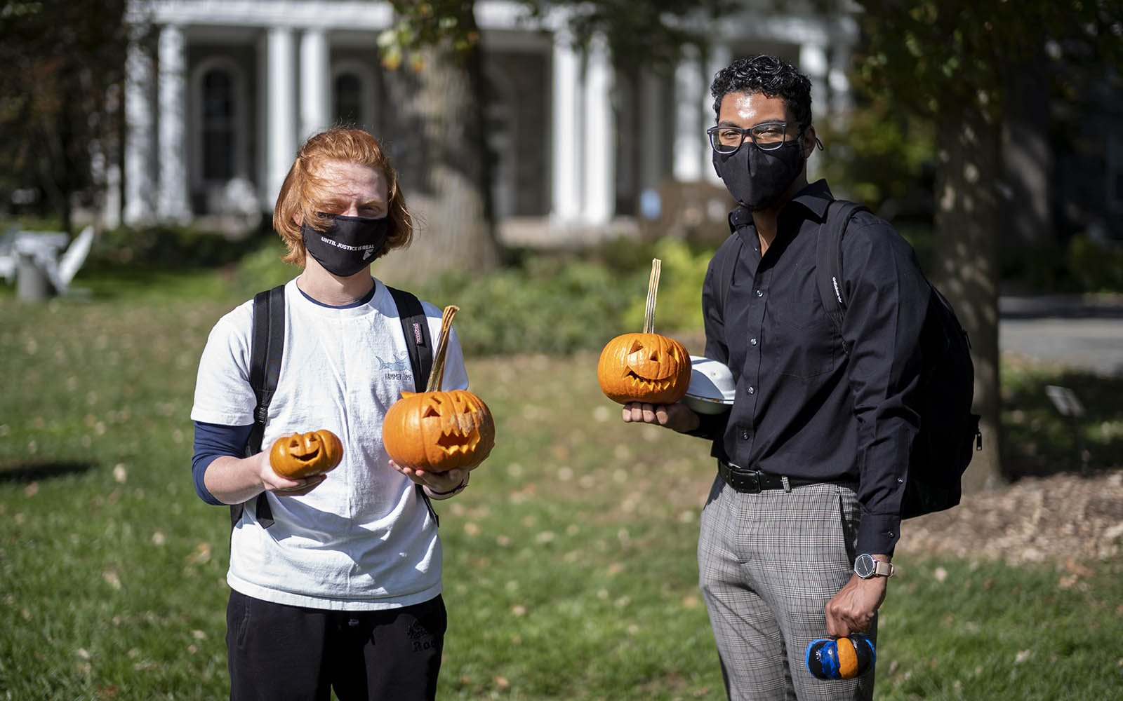 students showing off their pumpkins