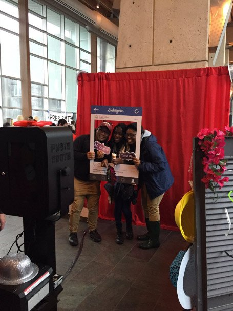 Students pose in a photobooth
