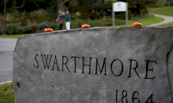Pumpkins sit on top of the Swarthmore College sign