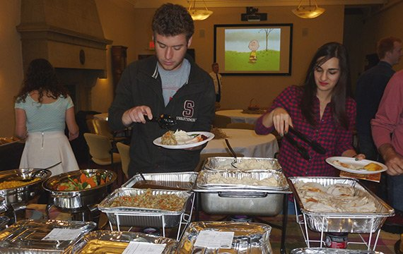 Staff and students at a Thanksgiving dinner