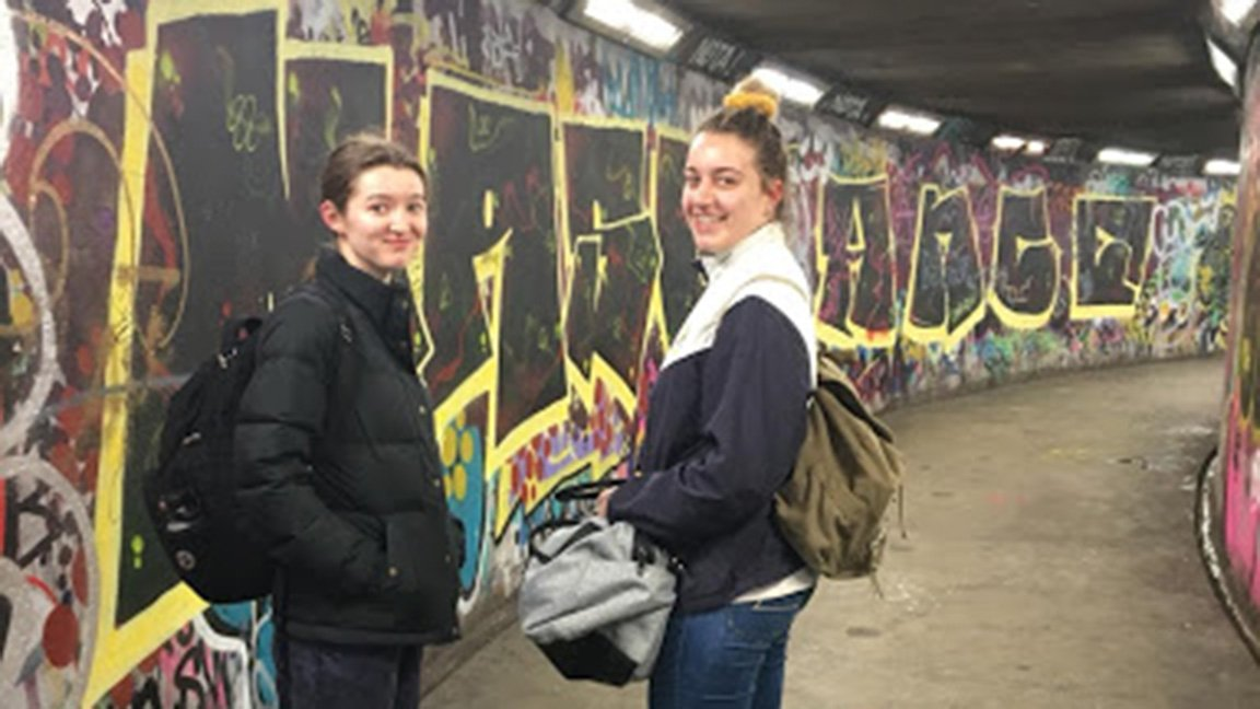 two students and graffiti