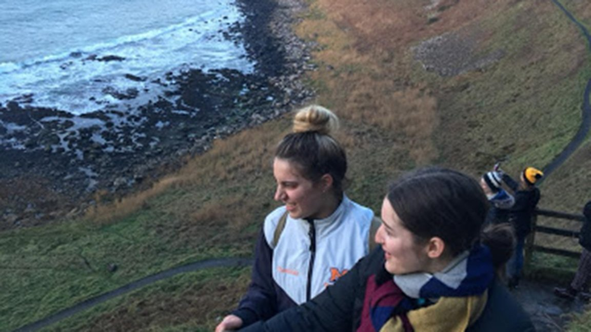 two students near the sea