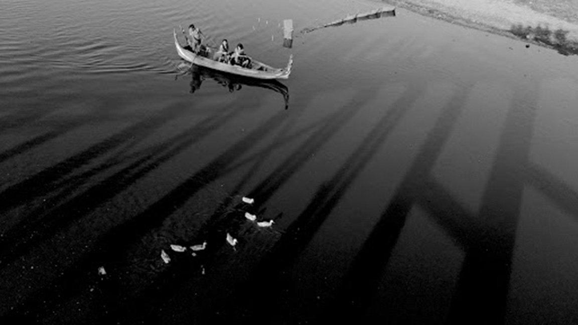 boats in water, birds eye view
