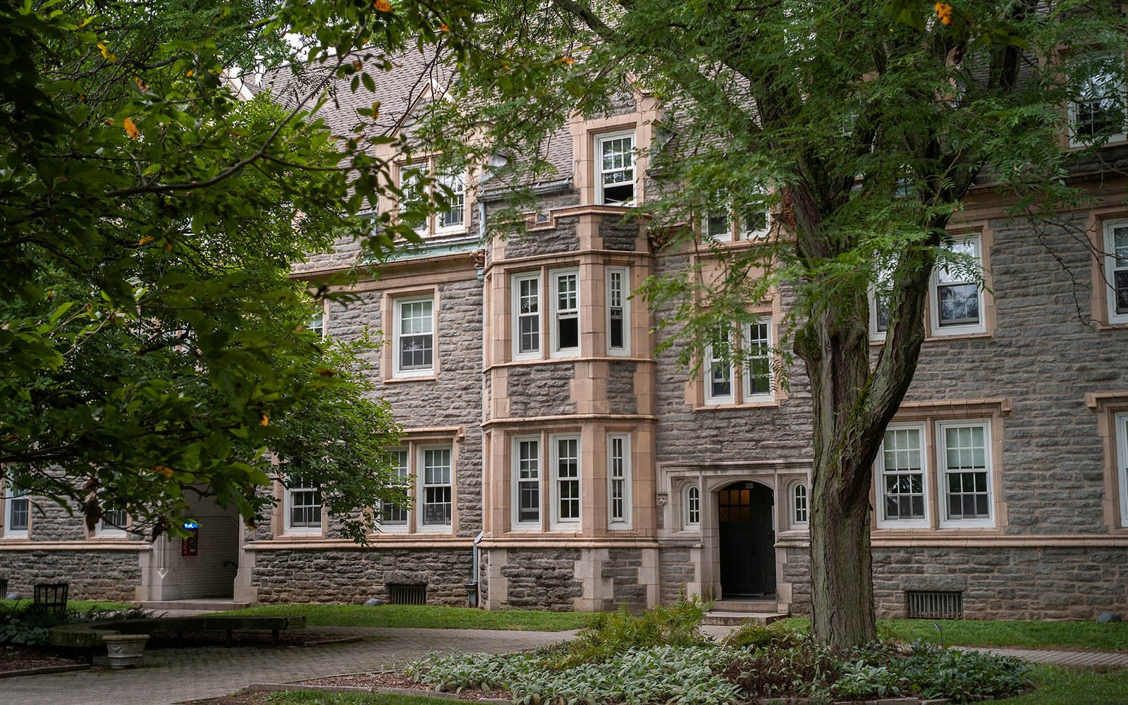 Exterior shot of Wharton Hall with trees in foreground