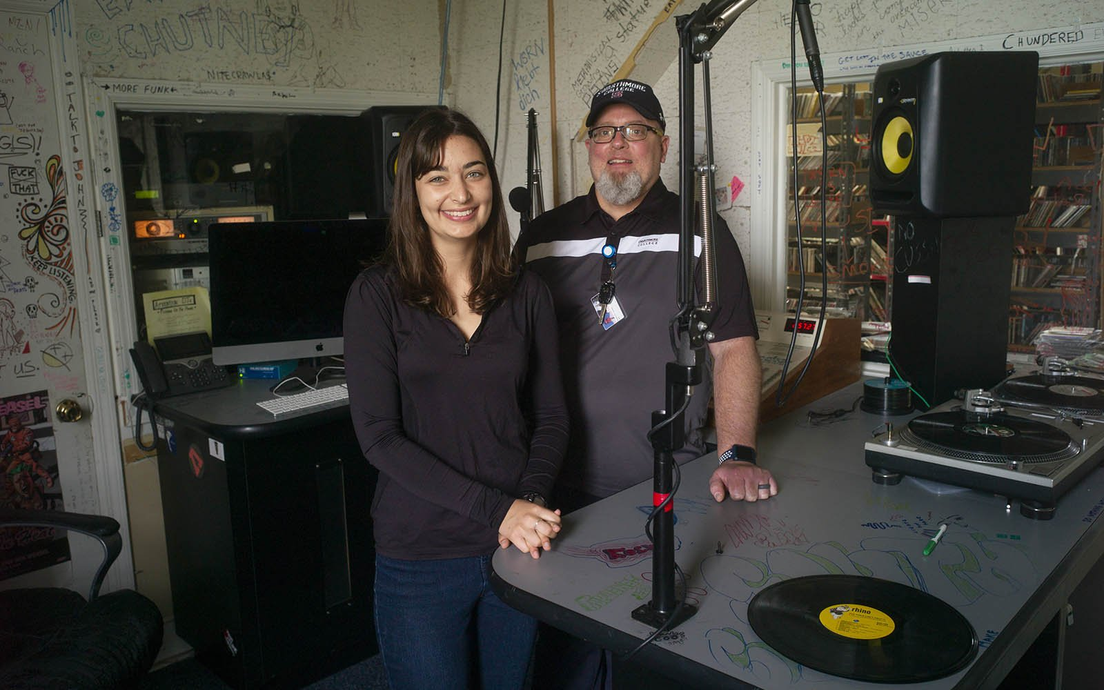 A student and staff member pose inside WSRN radio station