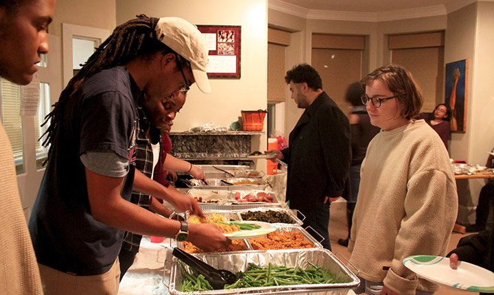 A student serves food at a Thanksgiving Dinner in the BCC