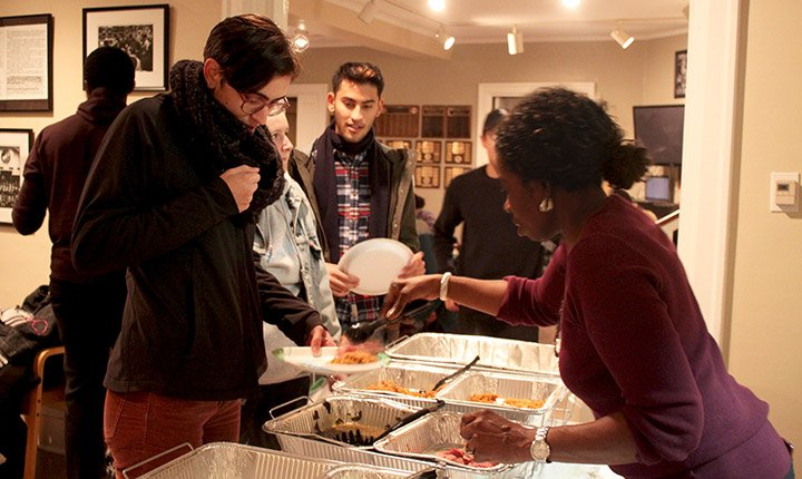 A student serves food during the BCC Thanksgiving dinner