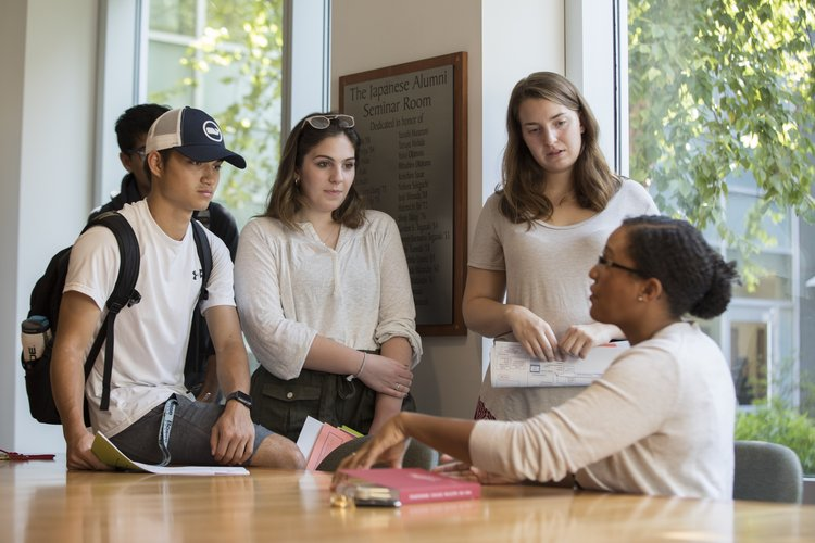 professor advising a small group of students