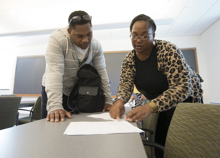 student and academic advisor reviewing a course plan